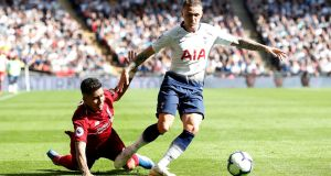 Tottenham's Kieran Trippier in action with Liverpool's Roberto Firmino: Spurs are  preparing for their third Champions League campaign in succession under Mauricio Pochettino.   Photograph: Paul Childs/Action/Reuters