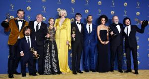 'Game of Thrones' cast members with their awards. Photograph:  Frazer Harrison/Getty Images