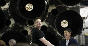 Elon Musk, ceo SpaceX, left, shakes hands with Yusaku Maezawa, who will be the first private passenger on a rocket around the moon. Photograph: Patrick T. Fallon/Bloomberg