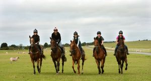 From left: Ciara Murphy, Ivan Tretyakov, Kirsty Burke, Anna O'Connor and Hazel Wallace ride out on the Curragh for trainer Tracey Collins. Photograph: Dara Mac Dónaill