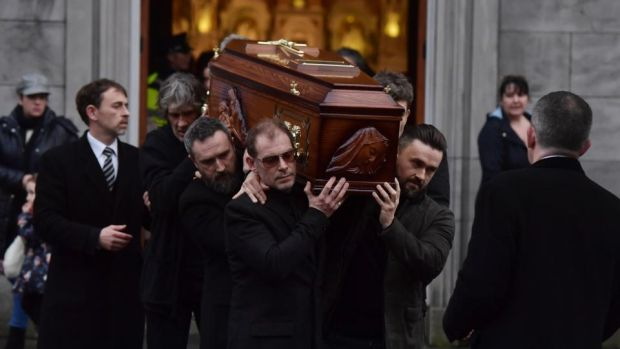 The Cranberries: Fergal Lawler (centre), Noel Hogan (second left) and Mike Hogan (right) help carry Dolores O'Riordan's coffin on January 21st, 2018. Photograph: Charles McQuillan/Getty