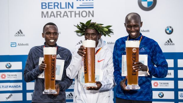 Kipchoge (C) poses with Amos Kipruto and Wilson Kipsang (R) all of Kenya during the ceremony. Photo: Maja Hitij/Bongarts/Getty Images