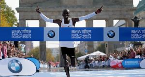 Eliud Kipchoge runs to win the 45th Berlin Marathon on Sunday. Kipchoge set a new world record in 2 hours 1 minute 39 seconds. Photo: Markus Schreiber/EPA