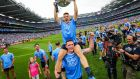 Dublin's Eoin Murchan and Brian Fenton celebrate with the Sam Maguire after beating Tyrone in Croke Park. Photo: Ryan Byrne/Inpho