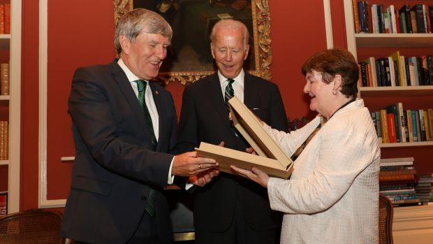 Former US vice-president Joe Biden at a reception for the launch of the Cambridge History of Ireland at the Irish ambassador's residence in Washington on Monday, with Ambassador Dan Mulhall and Prof Bríona Nic Dhiarmada from the University of Notre Dame, presenting Mr Biden with a special edition of a book on the Easter Rising. Photograph: Marty Katz