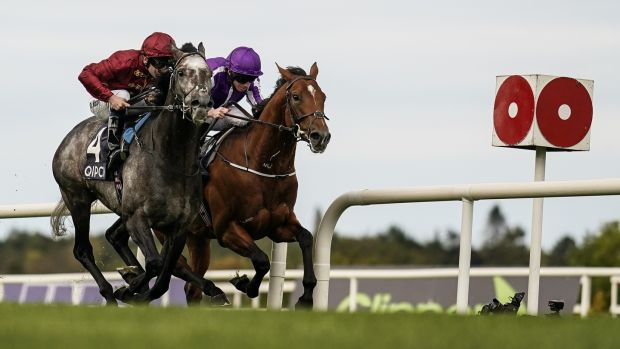 Oisin Murphy riding Roaring Lion (left) wins The Irish Champion Stakes from Ryan Moore and Saxon Warrior. Photograph: Alan Crowhurst/Getty Images