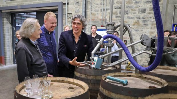 The first barrel containing malt whiskey made with barley harvested on the Slane Castle estate being filled at Slane Distillery last month. Slane Irish Whiskey co-founders Lord Henry Mount Charles (left) and Alex Conyngham (centre) with Alan Buckley, assistant distillery manager. Photograph: Marc O'Sullivan
