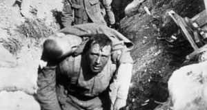 A frame from the documentary film 'The Battle of the Somme'. The soldier carrying a wounded comrade through trenches at the Battle of the Somme may have been a Dubliner.