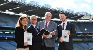 Elish Kelly and  Alan Barrett of the ESRI, GAA president John Horan and GPA chief Séamus Hickey at the launch of the ESRI report at Croke Park on Tuesday. Photograph: Sam Barnes/Sportsfile