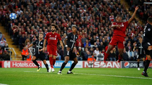 Liverpool's Daniel Sturridge scores their first goal during the Champions League Group C game against Paris St Germain at Anfield. Photograph: Phil Noble/Reuters