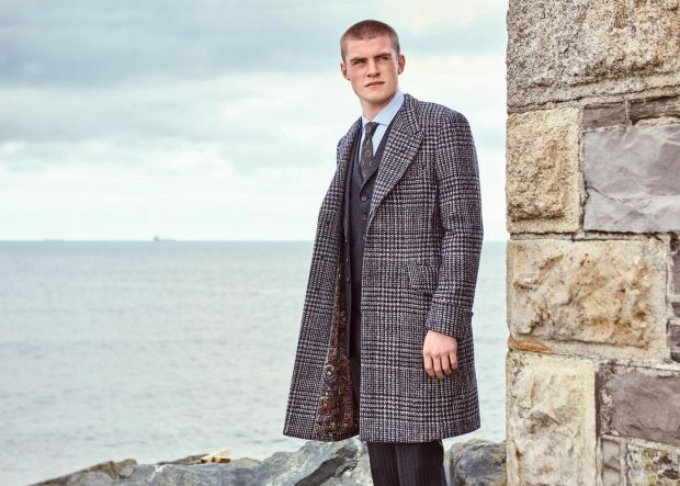 Fly fronted tweed coat with deep cuff and printed lining worn with a navy three piece suit. Paul Smith Collectiion. Photograph: James Mooney