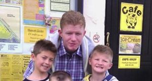 Jonathan O'Driscoll (22), at back, with his two younger twin brothers, Patrick and Tommy (9).