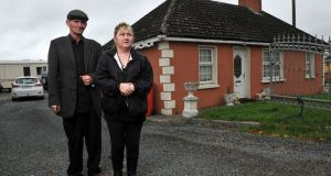 Parents Thomas and Helen O'Driscoll  outside the house  in Charleville, Co Cork where their twin boys Patrick and Thomas were killed. Photograph:  Daragh Mc Sweeney/Provision