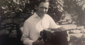 Jim McDaid playing the accordion in Donegal, 1966.