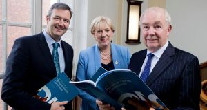Minister for Business, Enterprise and Innovation Heather Humphreys, Minister of State for Financial Services and Insurance Michael D'Arcy and commission chair Mr Justice Nicholas Kearns at the launch of the report. Photograph: Iain White / Fennell Photography