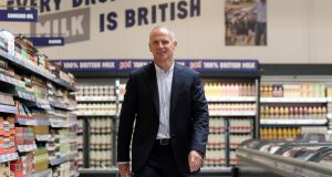 Tesco chief executive Dave Lewis strides the aisle of the company's new discount store Jack's in Chatteris, near Cambridge. Photograph: Daniel Leal-Olivas/AFP