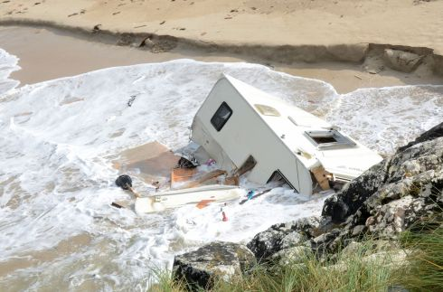 The scene in Claddaghduff in Co Galway where a tourist in her 50s was killed as her caravan was blown into the sea by Storm Ali. The caravan lying in the sea at Acton's beach campsite in Claddaghduff. Photograph: Paul Mealey