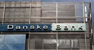 Danske Bank fell 3.4 per cent following the resignation of its chief executive and an update on a money laundering probe that prompted the bank to cut its full-year outlook.