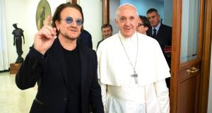 Bono with  Pope Francis at the Vatican on Wednesday, the U2 singer was meeting the pontiff to sign an agreement between Bono's charity, ONE, and the Scholas Occurentes educational charity. Photograph: AFP/Getty Images