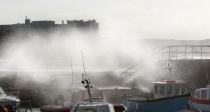 The sea pounds small boats in the harbour at Portstewart, Co Derry, as Storm Ali sweeps through the Causeway coast on Wednesday. Photograph: Margaret McLaughlin