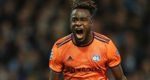 Maxwell Cornet of Lyon celebrates after scoring his team's first goal during the Champions League Group F match against Lyon  at Etihad Stadium. Photograph: Photograph: Richard Heathcote/Getty Images