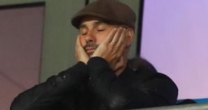 Pep Guardiola watched Man City's defeat to Lyon from the stands. Photograph: Martin Rickett/PA