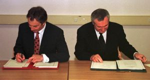 Tony Blair and Bertie Ahern signing the Belfast Agreement in 1998. Photograph: Dan Chung/Reuters