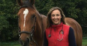 Carmel Molloy pictured here with a horse called Hope is a vet in an equine practice in West London