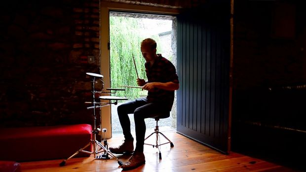 Ben Roe from Wicklow uses a practice kit at 21 Drums camp in Grouse Lodge, Co Westmeath. Photograph: Bryan O' Brien