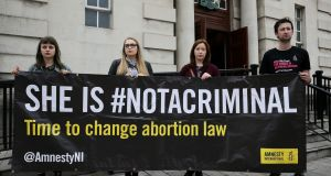 Pro-choice advocates outside the High Court in Belfast where where a case involving a mother who was prosecuted for securing abortion pills for her daughter was due to take place. Photograph: Brian Lawless/PA Wire.