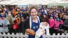 Emma Ferguson from Trim, Co Meath, with her two-week-old son Paddy  after winning the National Brown Bread Baking Competition at the National Ploughing Championships. Photograph: Leon Farrell Photocall Ireland