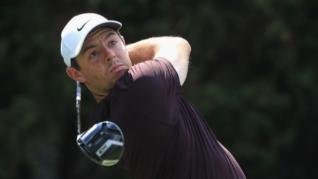 Rory McIlroy plays his shot from the eighth tee during the first round of the Tour Championship at East Lake golf club. Photograph: Sam Greenwood/Getty Images