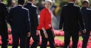 British prime minister Theresa May looks back following an EU leaders' group photo on the second day of a summit in Salzburg, Austria. Photograph: Sean Gallup/Getty Images