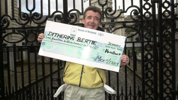 Ryanair: Michael O'Leary outside Government Buildings in October 2003 before handing in a cheque for €14 million – his estimate of his taxes – to Bertie Ahern while criticising the government for the lack of competing terminals at Dublin Airport. Photograph: Alan Betson