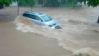 Cars float away as Mexico hit by flash floods