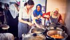 Meghan, Duchess of Sussex, cooking with women in the Hubb Community Kitchen at the Al Manaar Muslim Cultural Heritage Centre in West London, in the aftermath of the Grenfell Tower fire. Photograph: AFP/Getty Images
