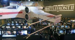 Belgian authorities declared some loot box systems to be illegal gambling and compelled major game developers to remove such features in games sold in the country. Above, gamers play the video game Star Wars Battlefront II  during the Paris Games Week last year. Photograph: Chesnot/Getty Images
