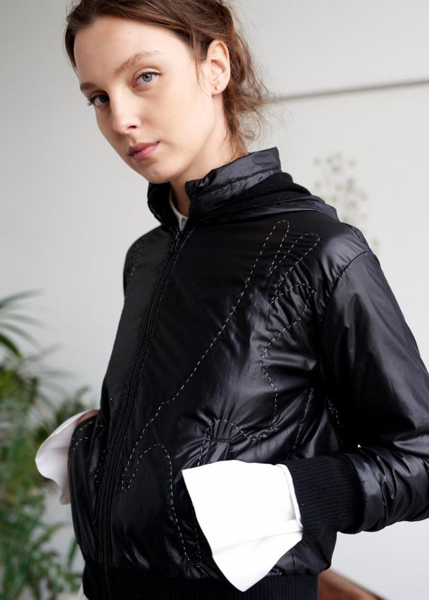 Moosehorn in black reflective cashmere-lined parachute bomber jacket, hand-quilted with special reflective thread that has glass within, €980 by Sphere One.