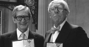 Denis Norden and Frank Muir with their CBEs at Buckingham Palace. Photograph:  PA