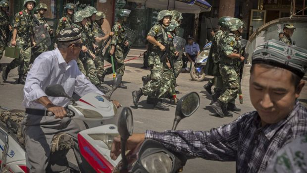 Chinese soldiers in Kashgar in Xinjiang: UN human rights experts, European governments and academics have criticised the detentions of more than one million people from the mostly Muslim Uighur population. File photograph: Kevin Frayer/Getty Images