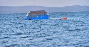 The upturned passenger ferry MV Nyerere  in the water near Ukara Island in Lake Victoria, Tanzania on Friday. Photograph: AP