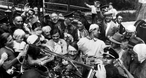 German peasants crowd around Adolf Hitler's car as he is driven into Berchtesgaden on September 9, 1934. Photograph: AP Photo/File