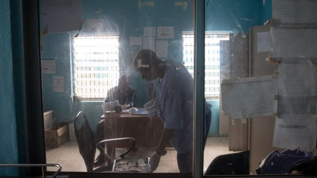 Medical staff organise before rounds in the TB Annex Hospital in Monrovia, Liberia. Photograph: Sally Hayden