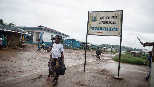 A sign points to Pleebo Health Centre, where some patients are diagnosed with TB in Maryland, Liberia. Photograph: Sally Hayden