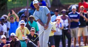 Tiger Woods shares the halfway lead with Justin Rose in the Tour Championship. Photograph: Tannen Maury/EPA