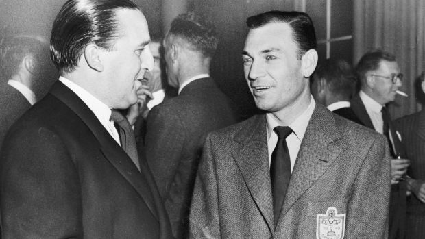 US captain Ben Hogan (right) chats to injured British player SM McCready at a reception in a London hotel. Photo: Getty Images