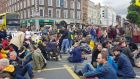Sit-down protesters on O'Connell Bridge on Saturday. Photograph: Kitty Holland