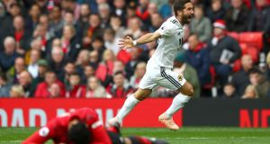 Joao Moutinho celebrates scoring Wolves' equaliser at Old Trafford. Photograph: Matthew Lewis/Getty