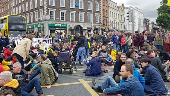 When the protesters encircled the bridge stewards urged people to sit down, thus blocking all entrances to the span from the quays. Photograph: The Irish Times