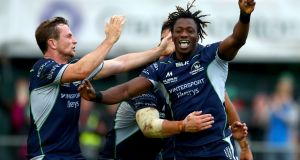 Connacht's Niyi Adeolokun celebrates scoring a late try in the Guinness Pro 14 game against Scarlets at the Sportsground in Galway. Photograph:  James Crombie/Inpho